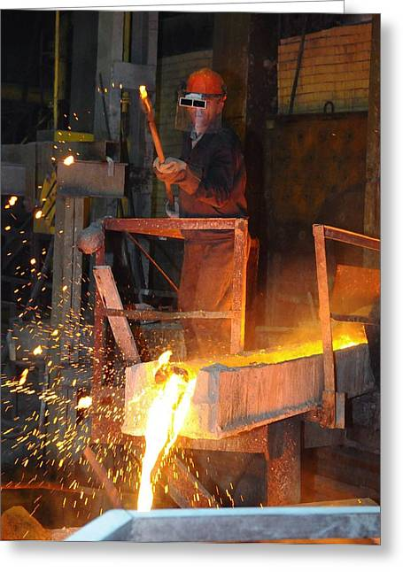 Smelter Greeting Cards - Molten copper flowing at a foundry Greeting Card by Science Photo Library