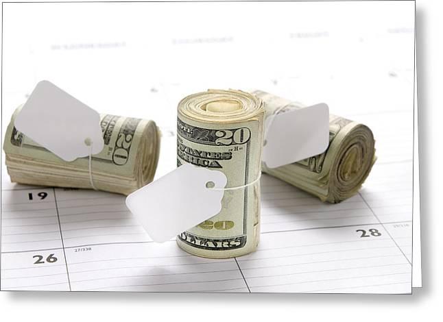 Money Rolls On Calendar Greeting Card by Joe Belanger