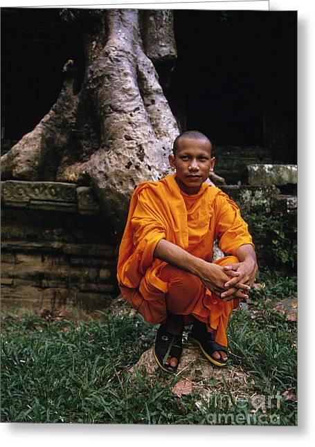Unrestored Greeting Cards - Monk at Preah Khan Temple Angkor Wat ruins near Siem Reap Camb Greeting Card by Ryan Fox