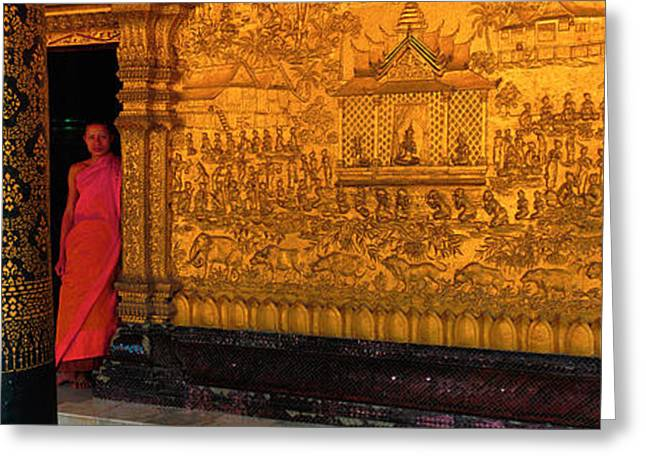 Interior Scene Photographs Greeting Cards - Monk In Prayer Hall At Wat Mai Buddhist Greeting Card by Panoramic Images