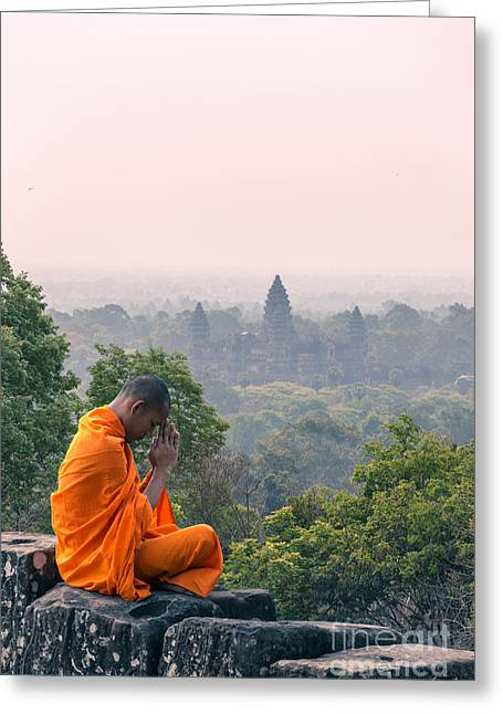 Real People Greeting Cards - Monk praying in front of Angkor Wat temples - Cambodia Greeting Card by Matteo Colombo