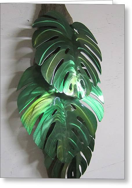 Garden Sculptures Greeting Cards - Monstera leaves on driftwood Metal sculpture Greeting Card by Robert Blackwell