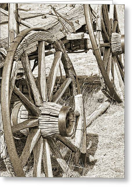 Montana Old Wagon Wheels In Sepia Greeting Card by Jennie Marie Schell