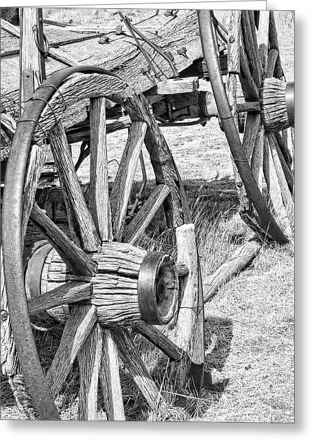 Wooden Wagons Greeting Cards - Montana Old Wagon Wheels Monochrome Greeting Card by Jennie Marie Schell