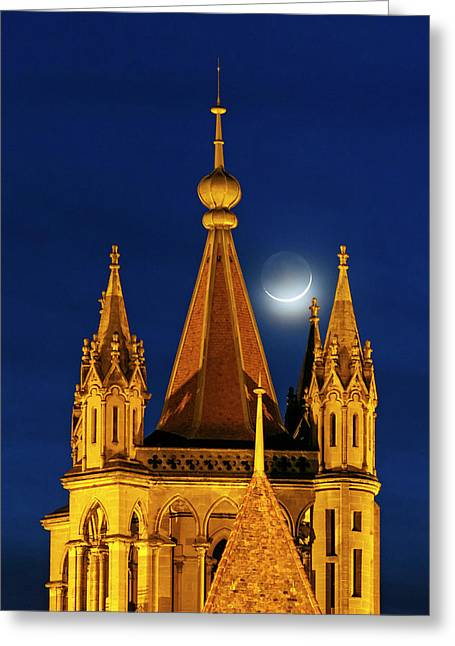Moon Over Cathedral Greeting Card by Babak Tafreshi