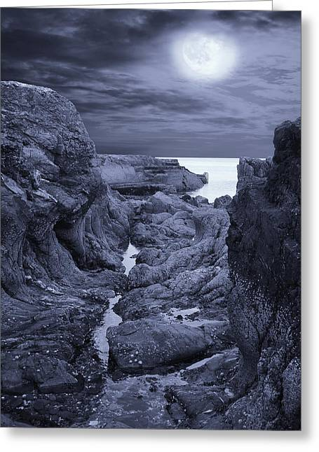Stepping Stones Greeting Cards - Moonlight over Rugged Seaside Rocks Greeting Card by Jane McIlroy