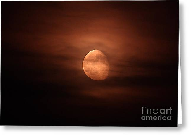 Waning Moon Greeting Cards - Moonrise Through Clouds Greeting Card by John Chumack