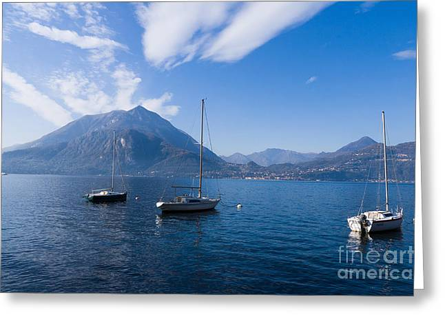 Charming Vistas Greeting Cards - moored yachts on Lake Como in Italy Greeting Card by Peter Noyce