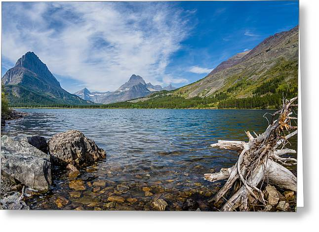 Reflection In Water Greeting Cards - Morning Colors of Swiftcurrent Lake Greeting Card by Greg Nyquist