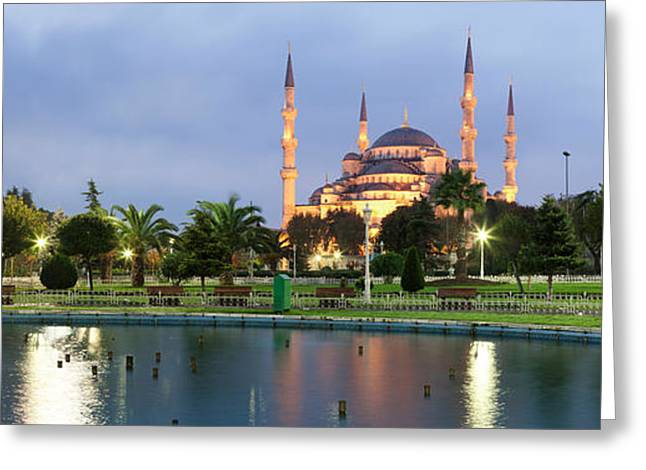 Istanbul Greeting Cards - Mosque Lit Up At Dusk, Blue Mosque Greeting Card by Panoramic Images