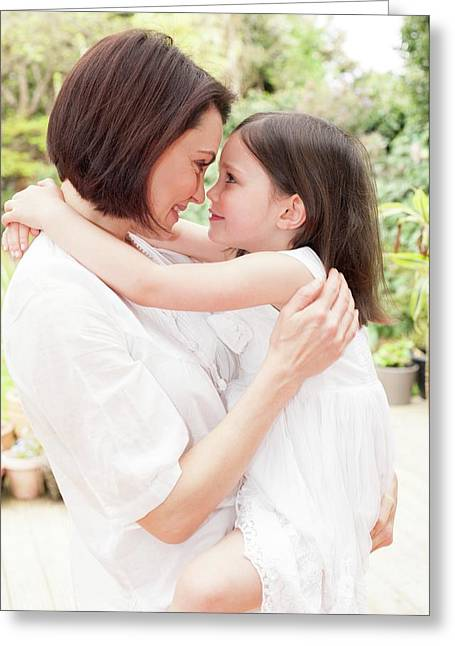 Mother And Daughter Hugging Greeting Card by Ian Hooton