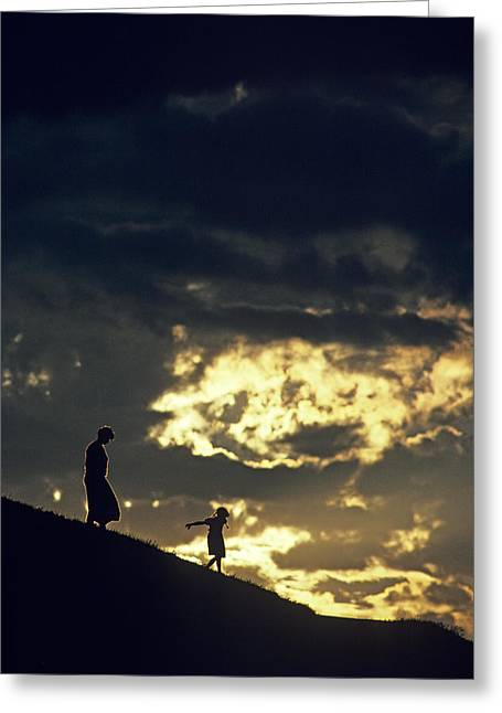 Youthful Greeting Cards - Mother and Daughter Silhouetted on Hillside Greeting Card by Jim Corwin