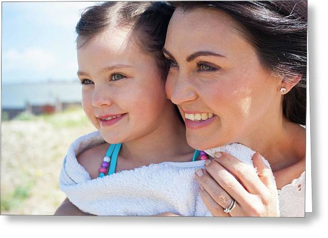 Mother And Daughter Smiling Greeting Card by Ian Hooton