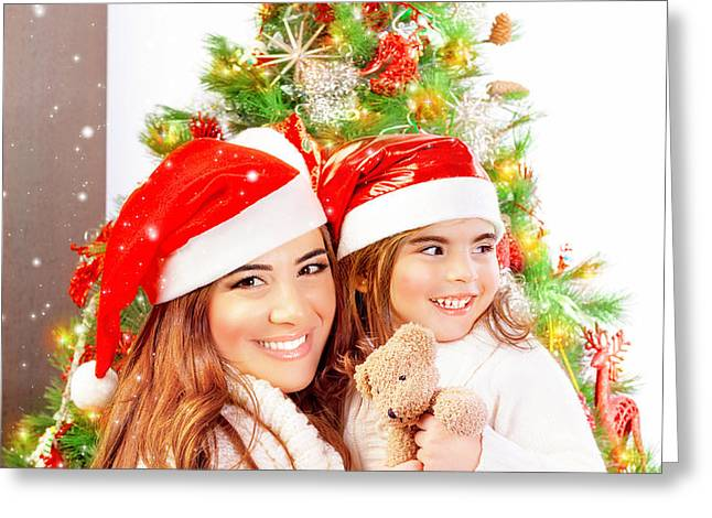 Mother with daughter celebrate Christmas Greeting Card by Anna Omelchenko
