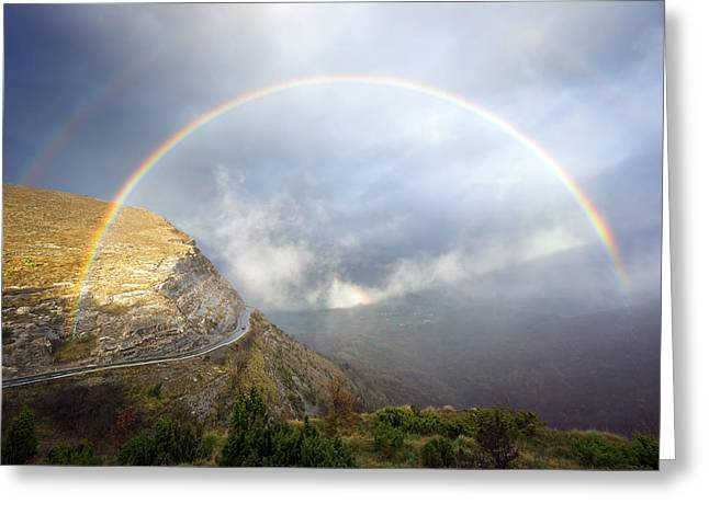 Pais Vasco Greeting Cards - Mountain Pass Road With Stormy Clouds And Rainbow Greeting Card by Mikel Martinez de Osaba
