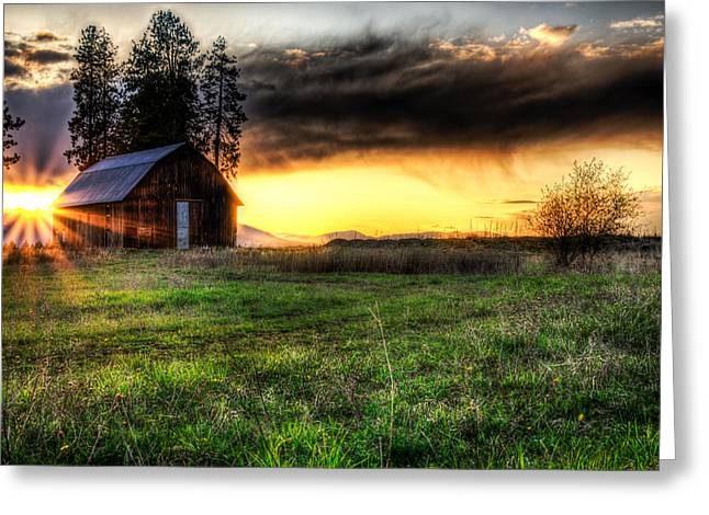 Barn Yard Photographs Greeting Cards - Mountain Sun behind Barn Greeting Card by Derek Haller