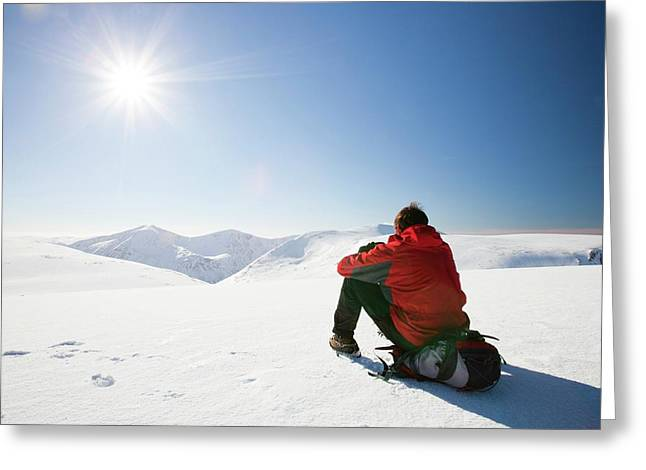 Mountaineer Resting At The Summit Greeting Card by Ashley Cooper