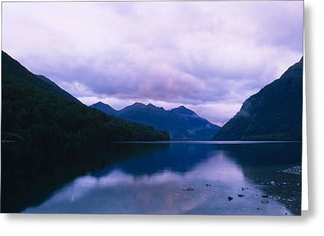 Overcast Day Greeting Cards - Mountains Overlooking A Lake Greeting Card by Panoramic Images