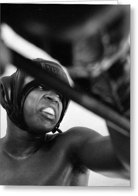 African-americans Greeting Cards - Muhammad Ali Looking Sideway Through Rope Greeting Card by Retro Images Archive
