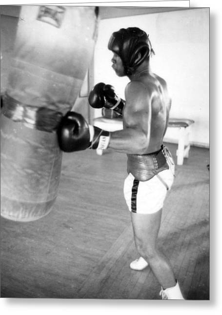 Work Out Greeting Cards - Muhammad Ali Punching The Heavy Bag Greeting Card by Retro Images Archive