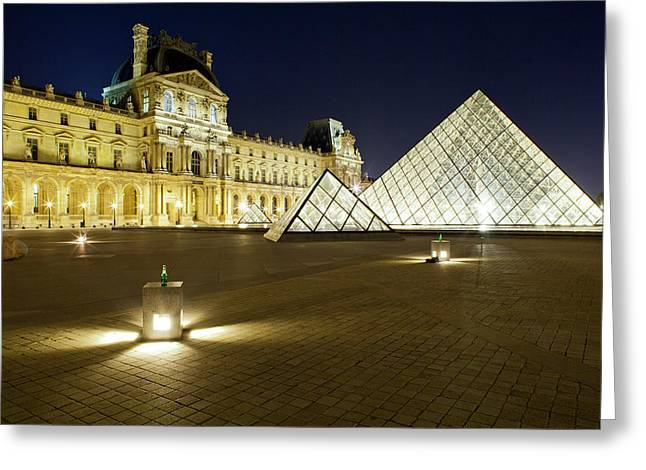 Museum With Glass Pyramid Lit Greeting Card by Panoramic Images