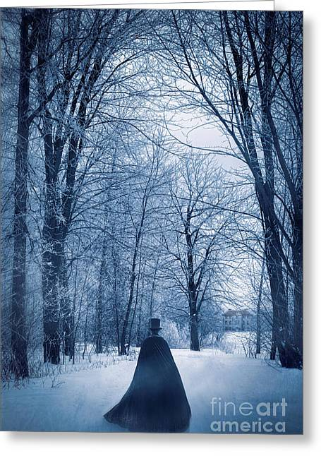 Snowy Evening Greeting Cards - Mysterious man with cape walking through the snow Greeting Card by Sandra Cunningham