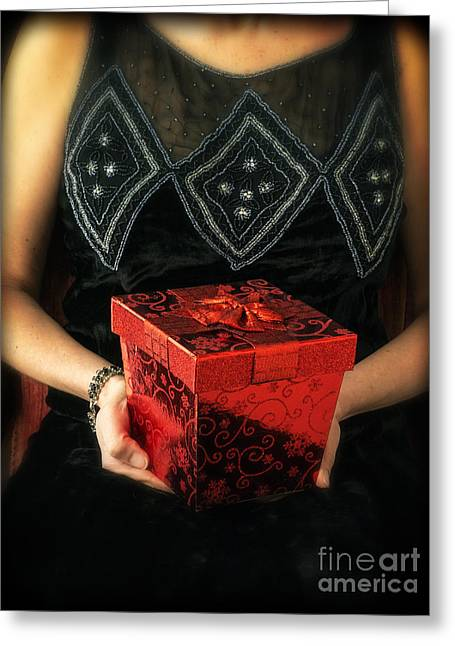 Mysterious Woman With Red Box Greeting Card by Edward Fielding