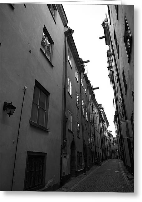 Buildings And Narrow Lanes Greeting Cards - Narrow medieval street in Gamla stan - monochrome Greeting Card by Intensivelight