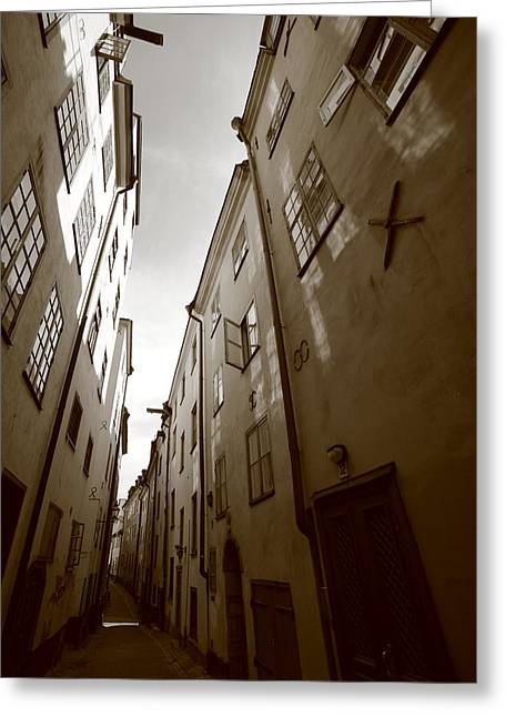 Buildings And Narrow Lanes Greeting Cards - Narrow medieval street in Stockholm - monochrome Greeting Card by Intensivelight