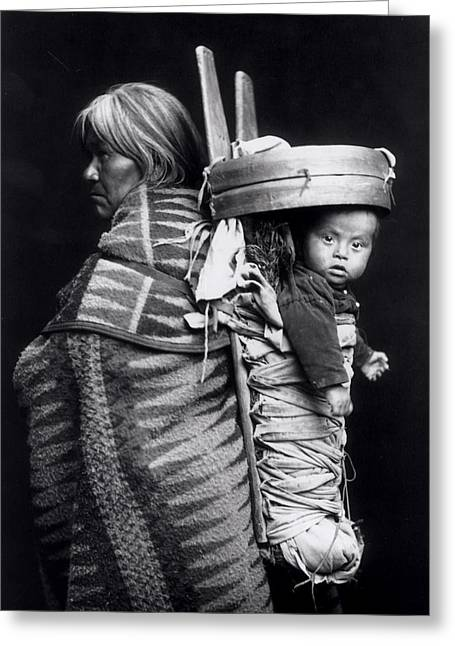 Textile Photographs Greeting Cards - Navaho woman carrying a papoose on her back Greeting Card by William J Carpenter