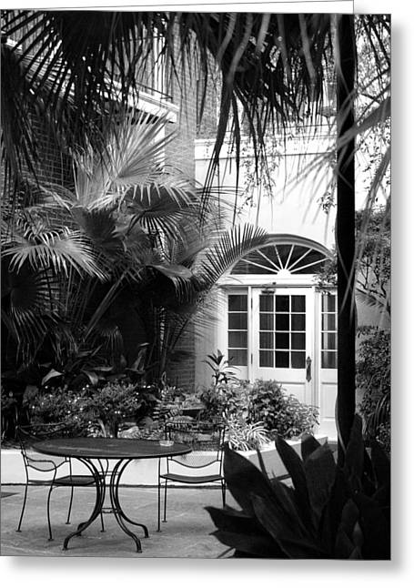 French Doors Greeting Cards - New Orleans Courtyard in Black and White Greeting Card by Greg Mimbs