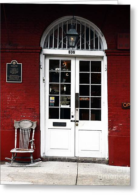 Red Buildings Greeting Cards - New Orleans Store Greeting Card by John Rizzuto