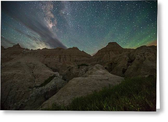 Badlands National Park Greeting Cards - Night Glow Greeting Card by Aaron J Groen