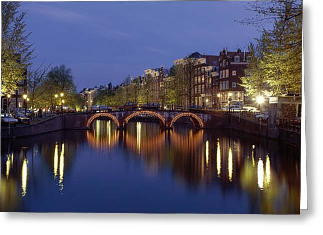 Roadway Greeting Cards - Night View Along Canal Amsterdam The Greeting Card by Panoramic Images