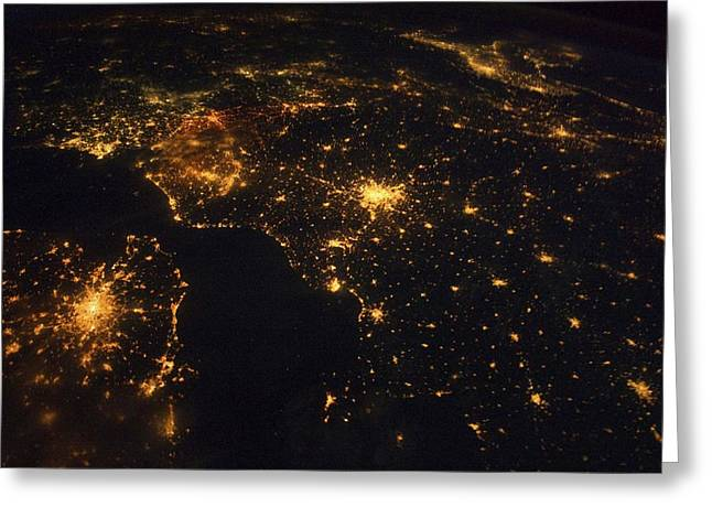 Inhabited Environment Greeting Cards - North-western Europe at night, ISS image Greeting Card by Science Photo Library