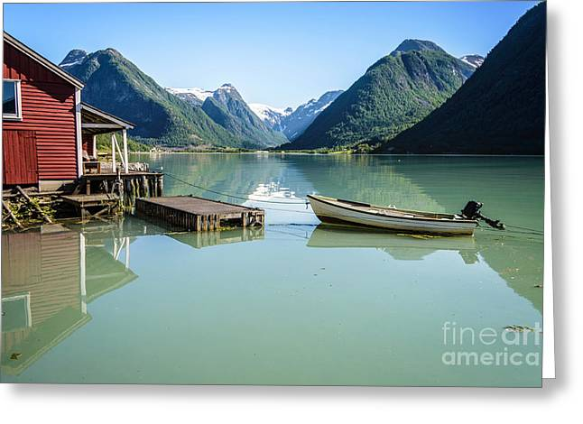 Norwegian Boathouses Greeting Cards - Reflection of a boat and a boathouse in a fjord in Norway Greeting Card by IPics Photography