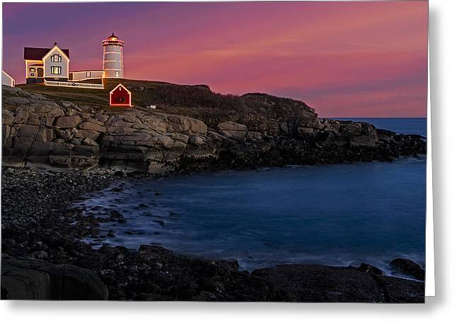Guiding Light Greeting Cards - Nubble Lighthouse At Sunset Greeting Card by Susan Candelario