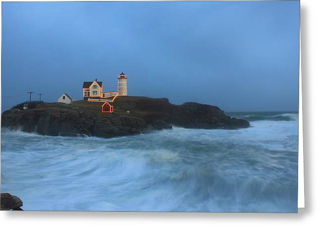 Cape Neddick Lighthouse Greeting Cards - Nubble Lighthouse High Surf and Holiday Lights Greeting Card by John Burk