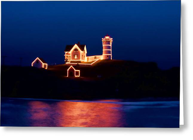 Nubble Lighthouse With Christmas Lights Greeting Card by Jeff Folger