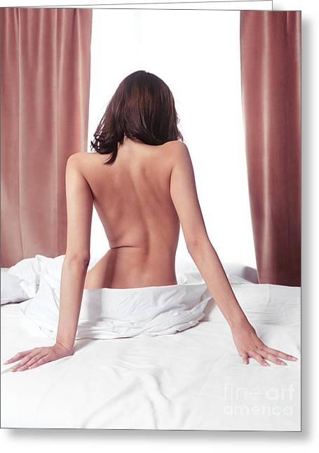 Healthy Sexuality Greeting Cards - Nude back of woman sitting on bed in front of window Greeting Card by Oleksiy Maksymenko