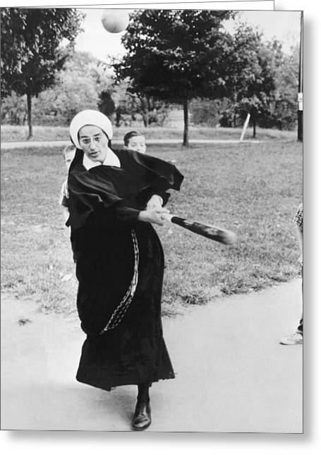 Religious Dress Greeting Cards - Nun Swinging A Baseball Bat Greeting Card by Underwood Archives