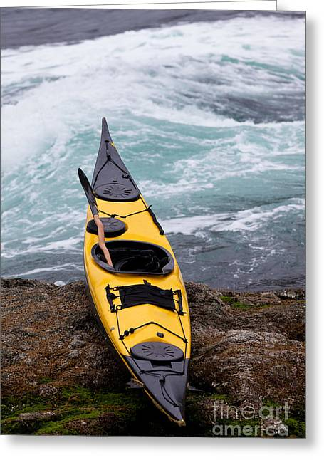 Solitary Activities Greeting Cards - Ocean kayak beached on rocky shore at tidal rapids Greeting Card by Stephan Pietzko