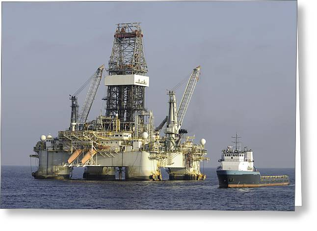 Sea Platform Greeting Cards - Ocean oil rig with supply boat Greeting Card by Bradford Martin
