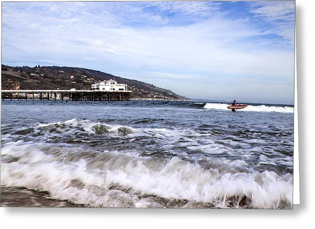 California Ocean Photography Greeting Cards - Ocean Waves Blue Sky And A Surfer At Malibu Beach Pier Greeting Card by Jerry Cowart