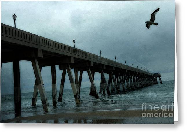 Wilmington Greeting Cards - Oean Pier - Surreal Stormy Blue Pier Beach Ocean Fishing Pier With Seagull Greeting Card by Kathy Fornal