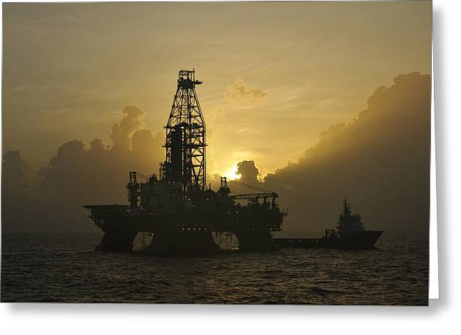 Sea Platform Greeting Cards - Offshore Oil Rig With Sun And Clouds Greeting Card by Bradford Martin
