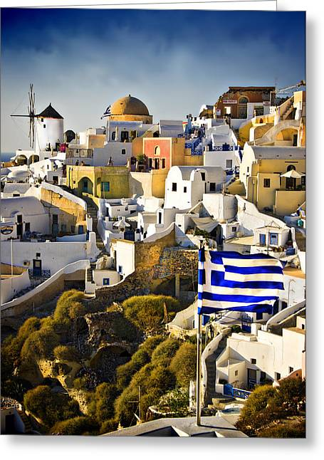 Santorini Greeting Cards - Oia and a greek flag Greeting Card by Meirion Matthias