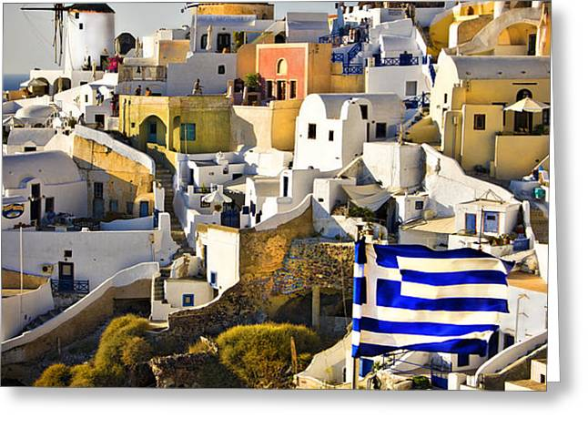 Oia and a greek flag Greeting Card by Meirion Matthias