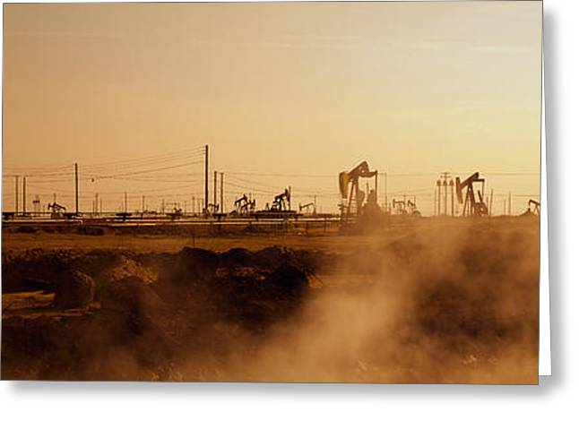 Evening Scenes Greeting Cards - Oil Drills In A Field, Maricopa, Kern Greeting Card by Panoramic Images