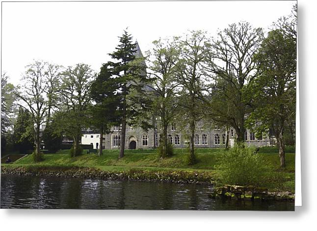 Cross On The Grave Greeting Cards - Oil Painting - The building of the St Benedict Abbey at the shore of Loch Ness Greeting Card by Ashish Agarwal